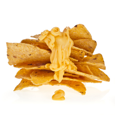 NACHO: tower of chip nacho snack with cheese sauce isolated on white background