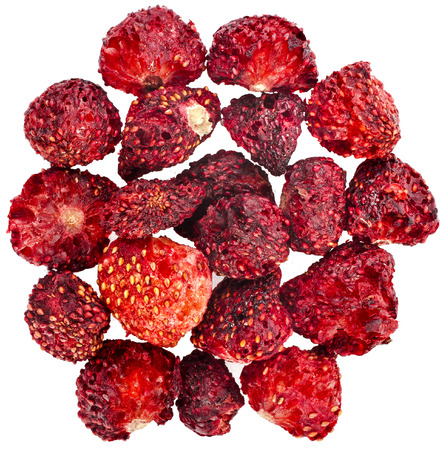 Heap pile of Dried Strawberries close up , surface top view , isolated on white background