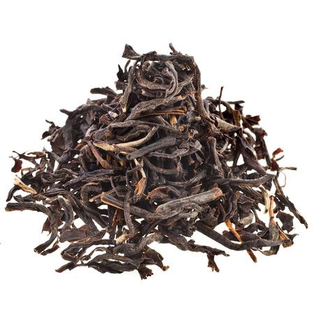 assam tea: dry black tea leaves \Assam\ India isolated on white background