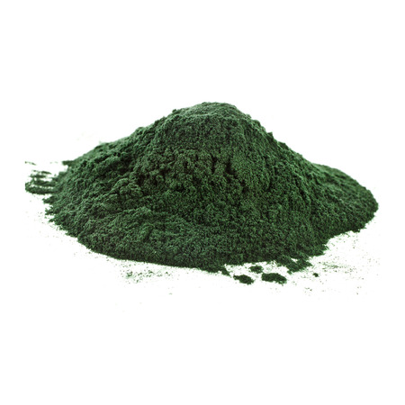 Spirulina powder algae nutritional supplement heap surface close up top view, isolated on white background photo