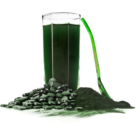 Spirulina algae powder glass drink nutritional supplement close up , isolated on white background photo