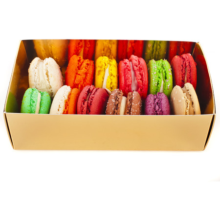 Macaroons in box isolation on a white background photo
