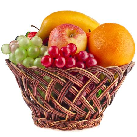 tasty summer fruits in backet isolated on white background photo