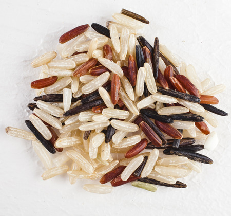 Color Gourmet Mix Rice (Brown red black wild) top view surface close up isolated on white background photo