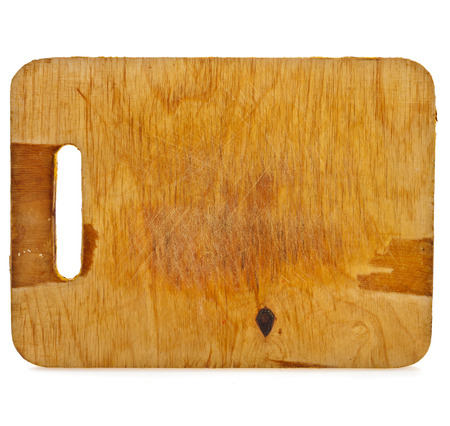 Old rustic wooden kitchen cutting board isolated on white background photo