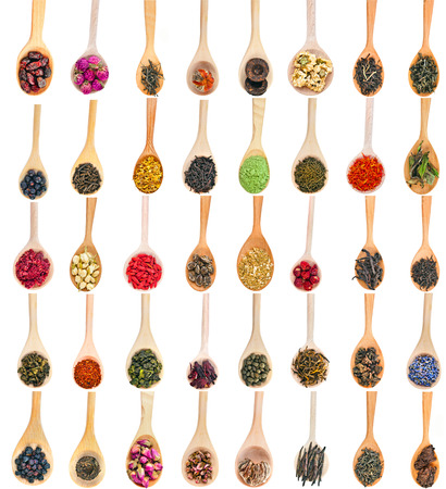 Collection Set of Tea Leaves and Fruit Berry Flower Additives in spoon top view, isolated on white background photo