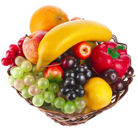 basket with fruits isolated on white background photo