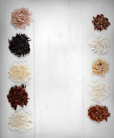 Collection rice on white wooden table surface photo