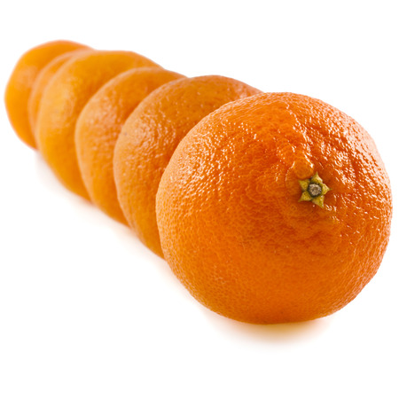 Five stacked row tangerines on a white background photo