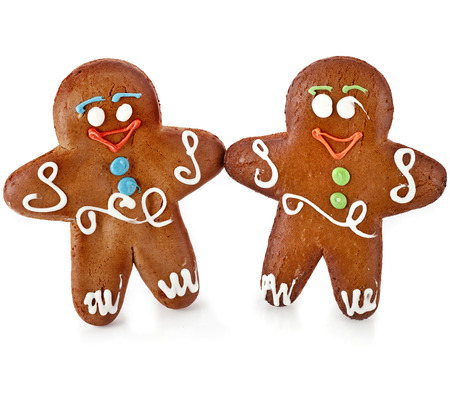 gingerbread: Two gingerbread mans isolated on white background Stock Photo