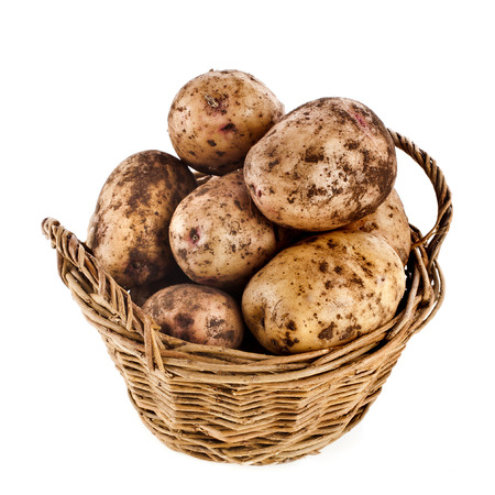 Potatoes heap in basket isolated