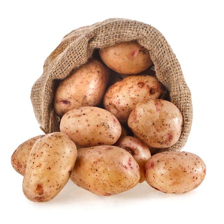 Raw potatoes in burlap bag
