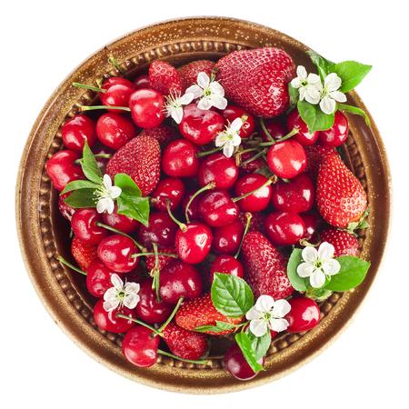 Sweet cherries and strawberries in bowl