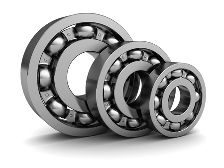 3d illustration of three ball bearings over white background