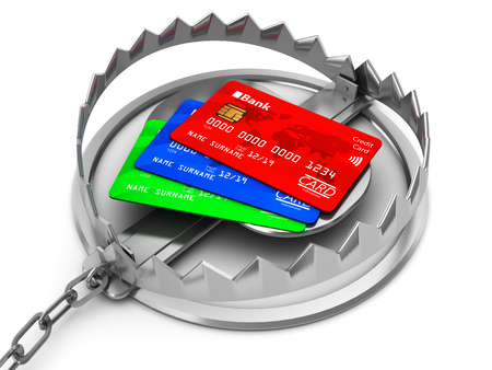 credit risk: 3d illustration of credit cards inside bear trap, financial risk concept