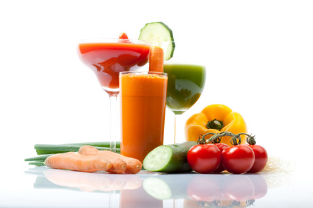 vegetable juices with cucumber, carrot, tomato photo
