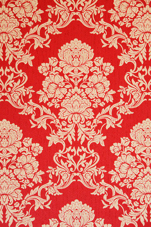 baroque wallpaper: elegant baroque wallpaper, red with golden rose design, closeup