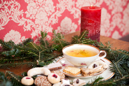 lighted: christmas decoration with herbal tea, lighted candle and christmas cookies Stock Photo