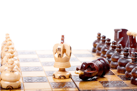in the ranks: Two Chess Kings between back ranks lines, one King checkmated the other, white background, space for your text,