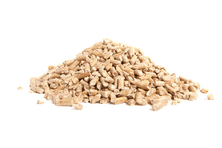 bio energy: stack of wooden pellets for bio energy, white background, isolated