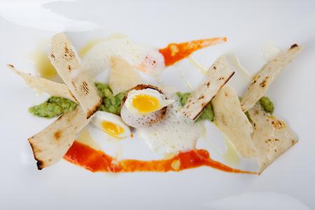 quail egg: fried scallop with quail egg, avocado dip, olive bread, Stock Photo