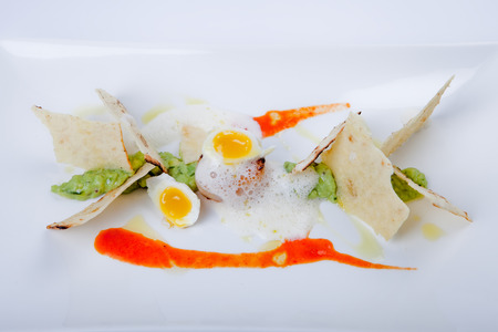 quail egg: exclusive sea food with fried scallop, fresh quail egg, olive bread and avocado dip
