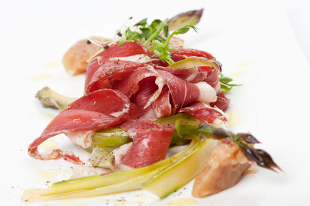 appetizer with smoked duck breast, marinated green ansparagus, banana chutney and fresh spice