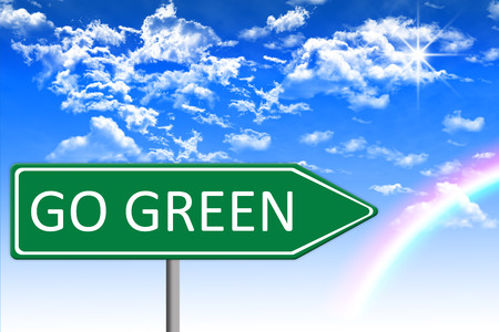traffic pole: Eco concept illustration, green traffic sign with go green message, blue heaven with clouds and sun in background, template on silver pole, white background