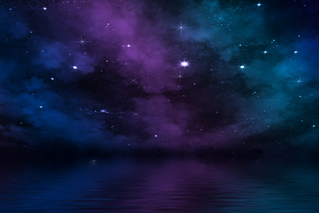 dramatic sky: dramatic nebula over sea with starry night sky, bright stars and colorful nebula, background