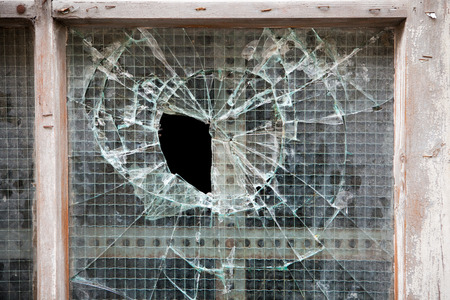 glass panel: broken glass panel in old wooden door, background