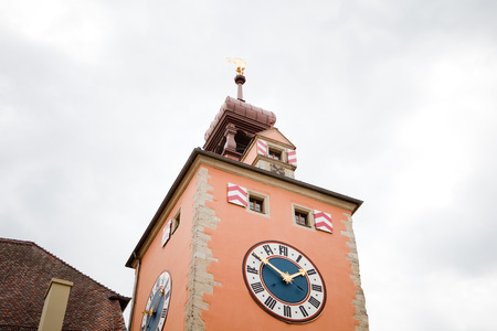 church steeple: medieval church steeple with church clock in regensburg, germany Stock Photo