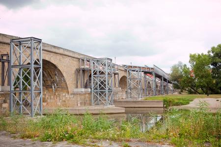 renewal: renewal of medieval stone bridge in regensburg, germany