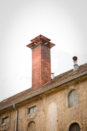 clinker: clinker chimney on roof of old house