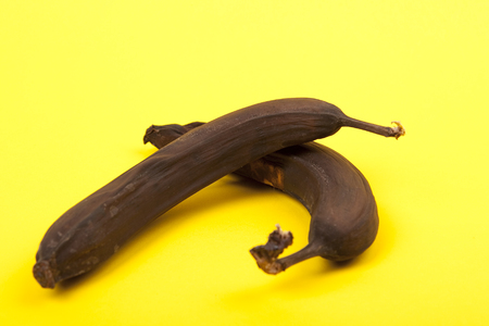 putrefied: conceptual food background with rotten bananas