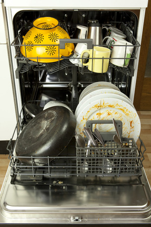filthy: opened dishwasher with filthy dishware