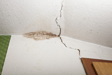 structural damage on ceiling of old house, mold in corner, crack in ceiling Stock Photo