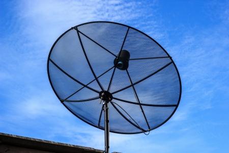 Black satellite dish with blue sky Stock Photo