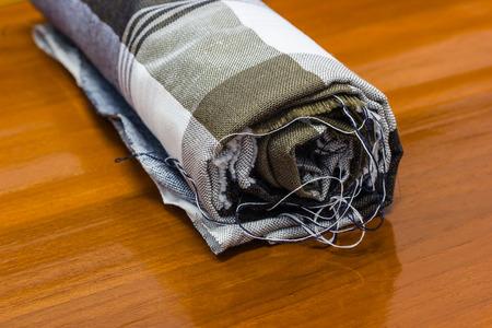 thai fabric on wooden floor photo
