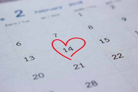 calendar with red heart mark on 14 February. Valentines day