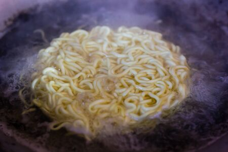 Instant noodle is boiled in the pan