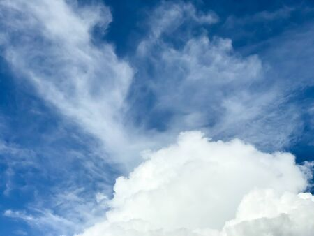 background with white clouds in the blue sky