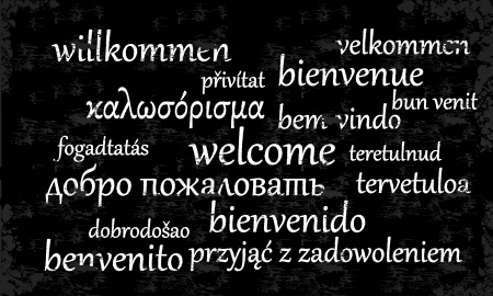 Welcome written in different languages on a chalkboard Vector