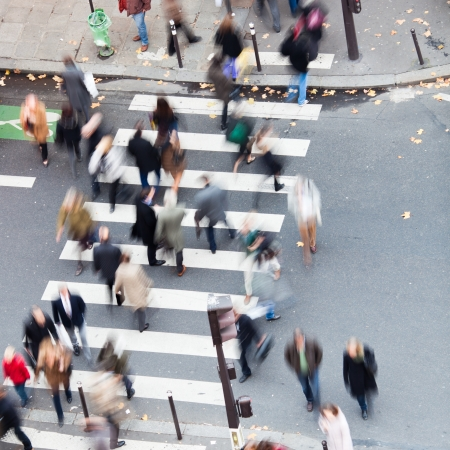 unrecognizable people crossing the road