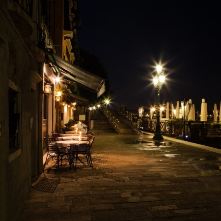 night view of a restaurant in Venice, Italy photo