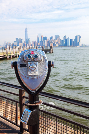 Antique binoculars on Liberty Iceland with view to Manhattan, New York City