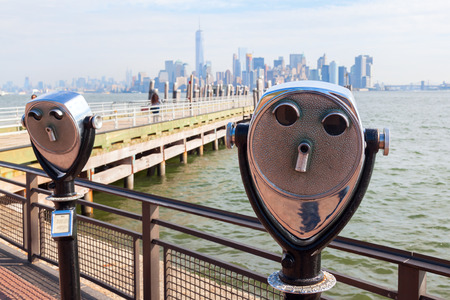 antique binoculars: Antique binoculars on Liberty Iceland with view to Manhattan, New York City