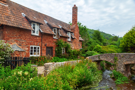 old packhorse bridge: old stone cottage with packhorse bridge in Allerford, Somerset, England Stock Photo