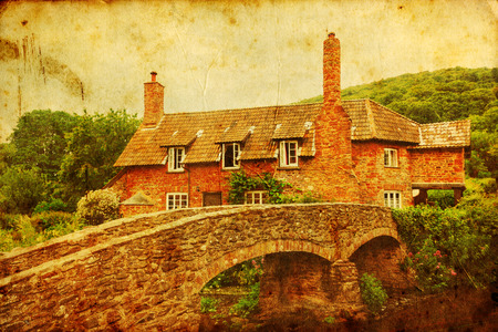 old packhorse bridge: vintage textured picture of a cottage with a historical packhorse bridge in Allerford, Somerset, England