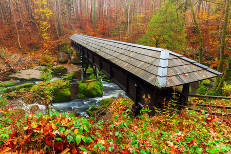uplands: footbridge at the Irrel Cascades at the river Pruem in the Eifel, Germany Stock Photo