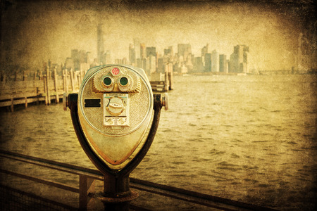 antique binoculars: vintage style picture of antique binoculars on Liberty Iceland with view to Manhattan, New York City